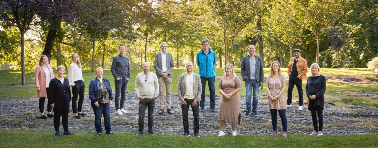 Picture of the staff at NordForsk, outside in a park in summer.